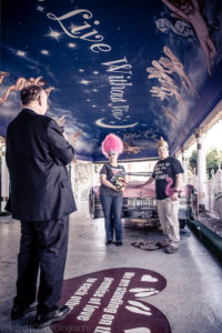 Las Vegas couple with pink Cadillac